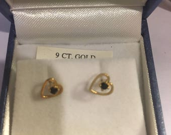 9ct gold heart shaped earrings with  sapphire
