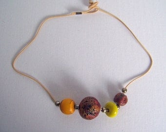 Beautiful jewelery which has warm red earth tones and it's light to wear.