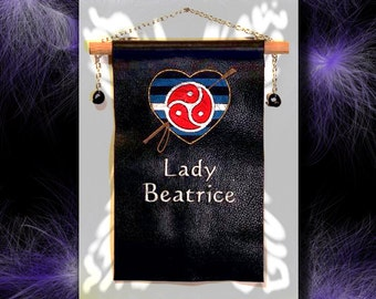 Personalized embroidered wall banner with crop & BDSM emblem.
