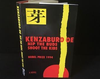 Kenzaburo Oe - Nip the Buds, Shoot the Kids Nobel Prize Winner 1995 1st Edition HBDJ Japanese Literature