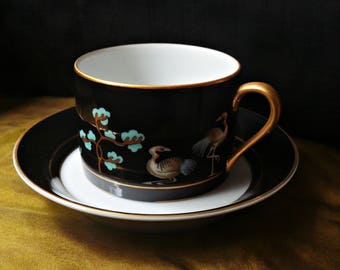 Fitz and Floyd CHINOISERIE Cup & Saucer, Black Laquer Look with Buddha, Birds, Temple / Pagoda, Gold Trim, Oriental Teacup / Coffee Cup