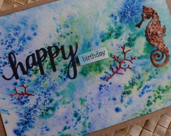 Happy birthday ocean-themed card with seahorse and coral