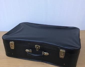 Old suitcase travel year 1950 Vintage black leather trunk