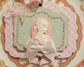 Vintage/Victorian soft, pink cameo with bling and bows Christmas ornament