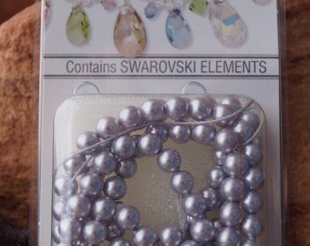 Pearl, Swarovski® crystals, lavender, 4mm round. Sold per pkg of 100.
