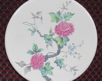 Hyalyn USA Trivet Of A Floral Design With An Attached Loop For Hanging