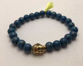 Peacock Blue with Gold Crackle Beaded flexible bracelet with a Gold Pewter Buddha Head and Mini Neon Yellow Tassel.