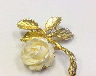 Vintage, carved rose brooch, signed Exquiste.