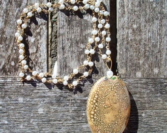 Beaded long necklace with handmade ceramic element