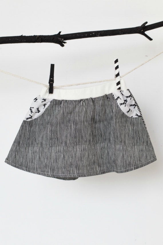 RÉGLISSE - flared skirt with white short and fakes pockets for kids - black striped and white with rabbits print