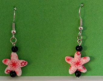 Pink star with black bead and silver fishhook