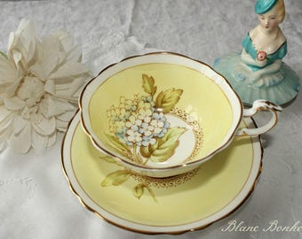 Paragon, England: Yellow tea cup and saucer, with blue hydrangea