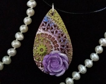 Multi-colored pendant with purple glittered rose.  Textured with details on front and back. FREE SHIPPING.
