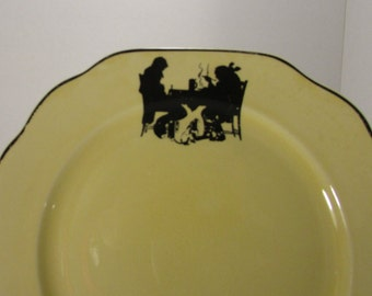 """Vintage Crooksville china co """"silhouette"""" plate, markings on back, couple eating with a begging dog between, great condition"""