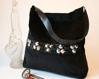 worn black handbag shoulder with hand embroidered gallon
