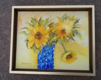 Sunflowers in blue crystal vase