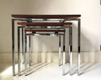 Nest tables, set of three occasional tables. Chromed base with wooden top. 60 's, Cees Braakman?