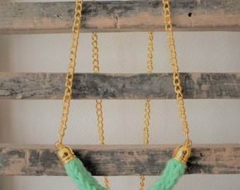 Clear green knitting wool and brass necklace