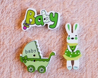 3 piece wooden buttons, buttons for kids. Lettering: Baby, Easter Bunny, baby stroller. Color green.