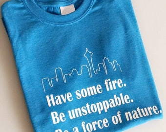 """Grey's Anatomy Cristina Yang Inspired """"Have some fire. Be unstoppable. Be a force of nature."""" Tshirt With Seattle Skyline"""