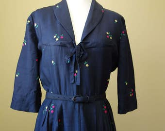 Vintage 1950s navy day dress with small floral print