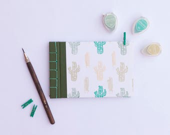 Album of photos or notebook with Cactus theme. Japanese binding