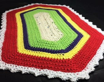 Beautiful crocheted colored rug.