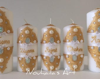 a golden decorated personalized candle set