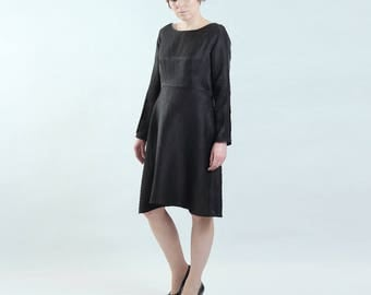 elegant black dress made of thin breathable fabric with long sleeves with slits