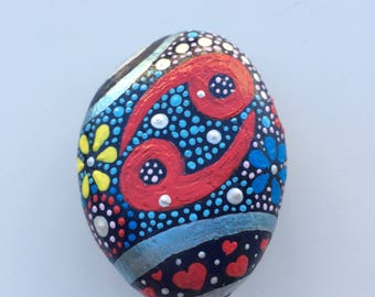Stone handpainted with Rhinestones, Sun sign cancer, blue background