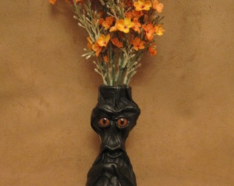"""Grichels small flower vase - """"Serpas"""" 29174 - black leather with rusty brown slit pupil fox eyes"""