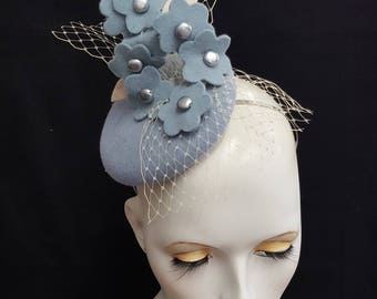 pale baby blue button fascinator cocktail hat with felt flowers beads and veiling headband fixing multitude of positions Ascot races wedding