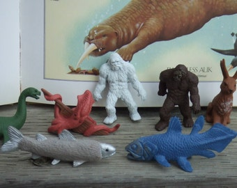 Set of 7 Mythical Creatures. Cryptozoology. Cake Toppers Made by Safary Ltd. Lead Free. Coelacanth, Furry Trout, Yeti, Big Footh and More.