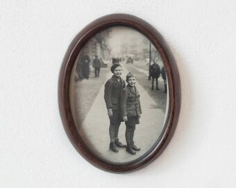 Mid Century Oval Wooden Frame with Vintage Black and White Picture of Two Boys Wearing Their Sunday Suit