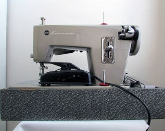 Early 1960s Sears Kenmore straight stitch sewing machine, model 148.280