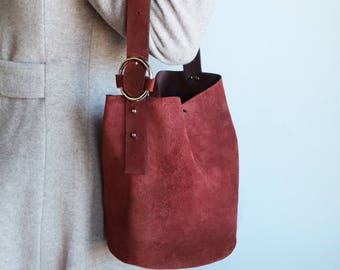 Laguna Bucket Bag in Ruby Red Suede leather bag with hoop bangle