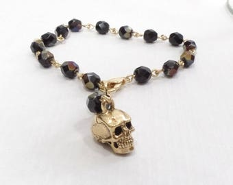 Iridescent Black Crystal Rosary Bead Style Bracelet with Gold Skull Charm
