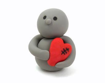 Cute Polymer Clay Person Figure Holding Red Mended Heart