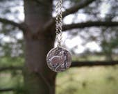Sterling Silver Double Sided Pendant Featuring Bunny Rabbit and Deer Hoof Print. Textured Silver Nature Inspired Artisan Necklace.