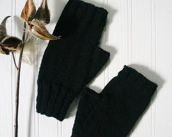 Men's fingerless gloves in black acrylic.  One size fits most men. Hand warmers.  Texting gloves. Ready to ship.