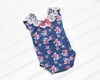 Dainty Little Garden - newborn romper in navy blue floral with raspberry pink, mauve, fuchsia, yellow, turquoise, peach, pink and aqua (RTS)
