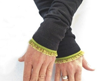 Arm warmers, fingerless gloves in black with ruffled trim in olive green