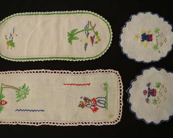 Four Embroidered Doilies