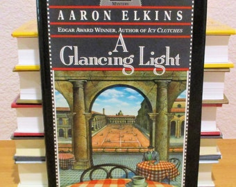 AARON ELKINS, A Glancing Light, 1st edition, 1991