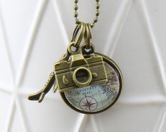 Small World Map Circle Glass Pendant with bronze Plane and camera charms on a Bronze Necklace - Australian Seller