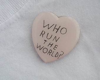 who run the world? brooch