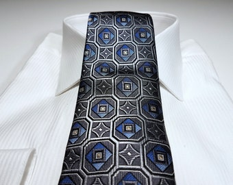 Silk Tie in Geometric Shades of Horizon Blue Charcoal Grey and Black
