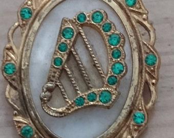 Vintage Irish green rhinestone brooch