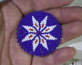 Vintage handmade beaded leather medallion