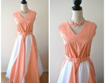 Lovely vintage salmon and white striped sleeveless belted tea length dress with full skirt.